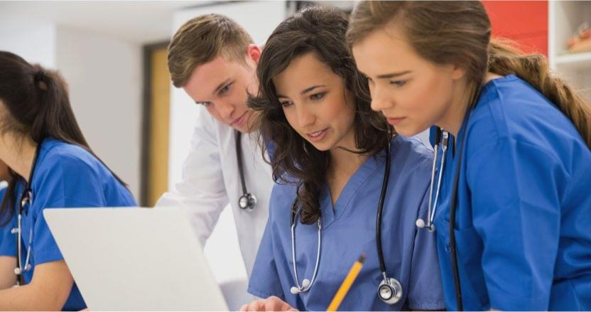 medical students looking at a laptop