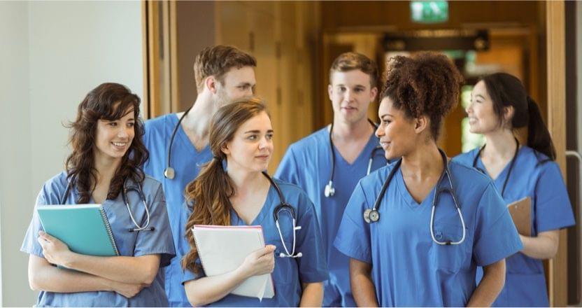 a group of nurses walking together